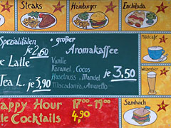 Restaurant-Werbung am Stadtbahnbogen