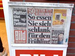 Zeitung mit Schlagzeile Schlank essen
