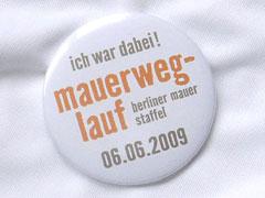 Mauerweg-Lauf-Button
