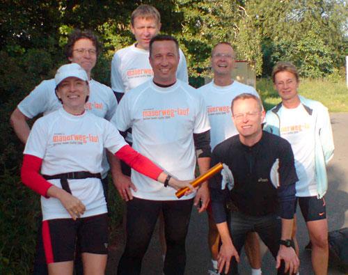 Die Staffelstab-Übergabe Läufer-Team 4
