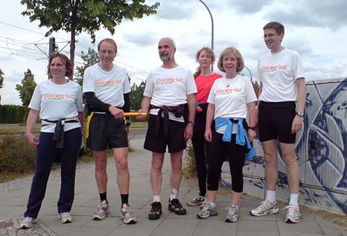 Staffelstab-Übergabe an Läufer-Team 9
