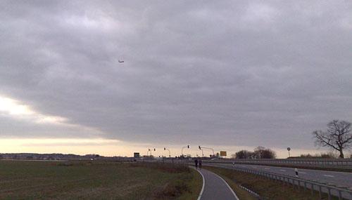 Läufer und Flugzeug