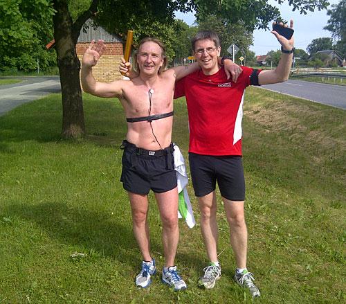 Läufer beim Etappenwechsel