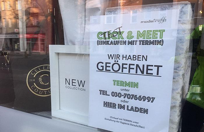 """Hinweis """"Click & Meet"""" (Click mit """"Test"""" überschrieben) an Boutique"""